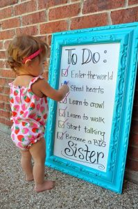 Child with to-do list pregnancy announcement