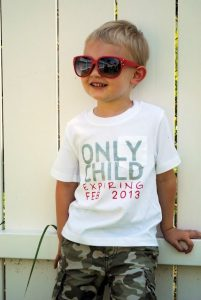 child announcing pregnancy shirt reads 'only child expiring'