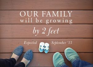 Tiny shoes arranged to announce pregnancy