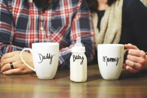 Mummy and Daddy coffee mugs with baby bottle for pregnancy announcement