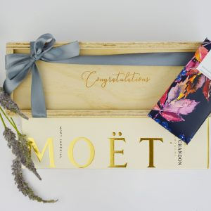 custom champagne hamper with congratulations engraved, moet bottle and chocolate