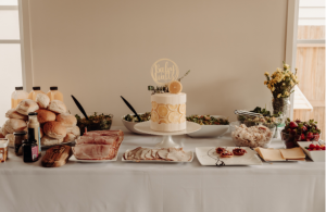 grazing table at baby shower with food selection and lemon cake