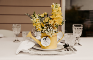 bumble and bloom flowers in mini watering can