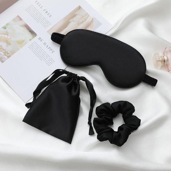black silk eye mask displayed on sheets