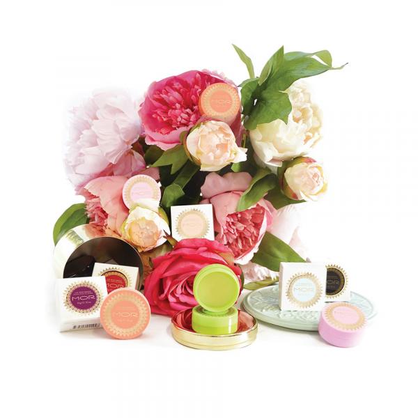MOR lip macarons displayed on flower boquet
