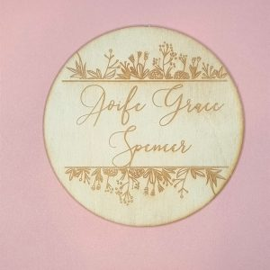 baby name announcement plaque with mixed flora embellishment