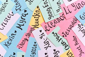 Colourful strips of paper with names writen on them